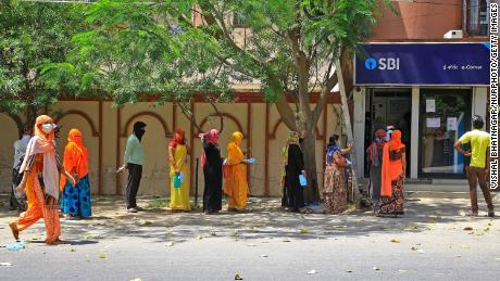 People are waiting in front of the bank during the closing in Jaipur, Rajasthan, India, on April 9th.