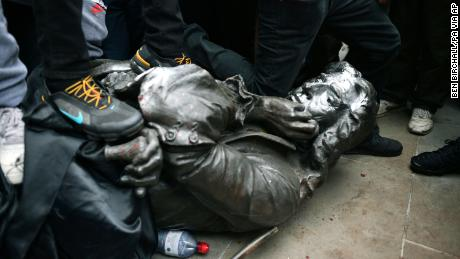 Protesters tore down a statue of slave trader Edward Colston during a Black Lives Matter protest rally at College Green, Bristol, England, on Sunday, June 7, 2020.
