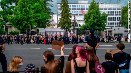 Crowds in front of the US Embassy in Warsaw, Poland.