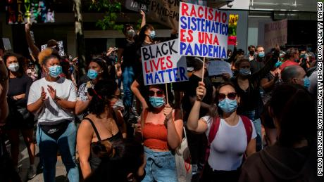 In Madrid, a protester warns of this