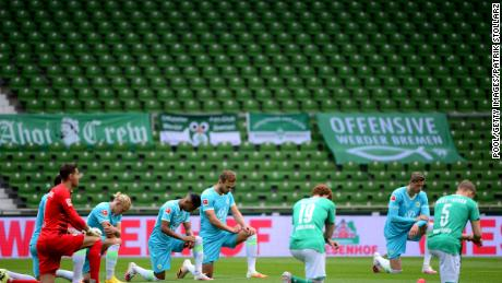 Players of both teams kneel to protest ahead of the Bundesliga match between SV Werder Bremen and VfL Wolfsburg in Germany on Sunday.