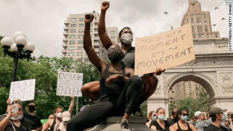 Protesters wear masks as they condemn the systematic racism and police killings of black Americans in Washington Square Park in Manhattan, on June 6, 2020 in New York City.