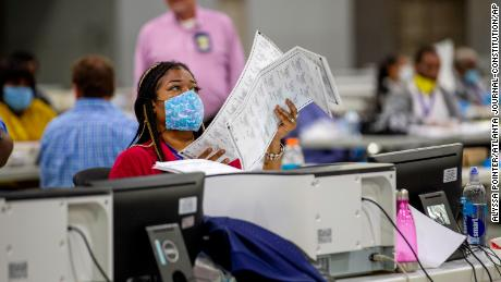 Fulton County employee Shaye Moss scans postage ballots at the Georgia World Convention Center during Georgia's primary election in Atlanta on Tuesday, June 9, 2020 (Alyssa Pointer / Atlanta Journal-Constitution via AP)