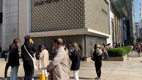 Shoppers preparing in May enter the Louis Vuitton boutique in Seoul.