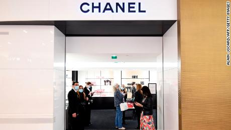 Shop assistants who greeted customers at Chanel in Galeries Lafayette, the first day the department store opened in Paris in May.
