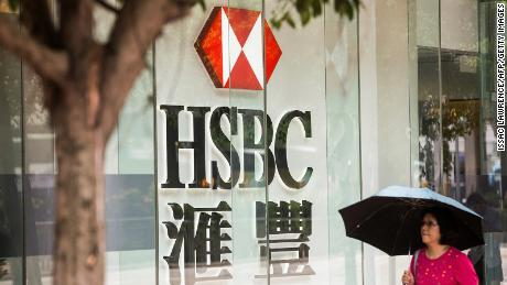 A pedestrian passing by HSBC in Hong Kong in 2017.