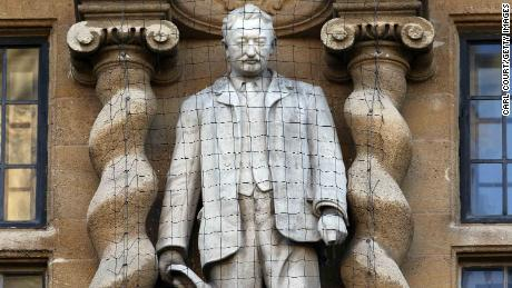 Who is Cecil Rhodes and why are British protesters protesting against his statue?