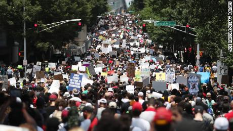 People are marching through the streets during a June 16 event organized by the One Race Movement in Atlanta, Georgia.