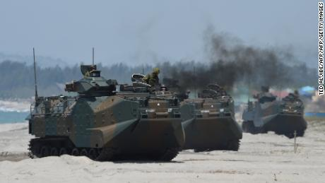 Japanese Ground Self-Defense Forces & # 39; Amphibious vehicles attacked the beach during an amphibious landing exercise in the Philippines in 2018.