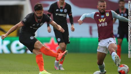 Chelsea French striker Olivier Giroud scores his team's winning goal as his shot deflects off the chest of challenging Conor Hourihane's boots to beat Orjan Nyland in an Aston Villa goal.