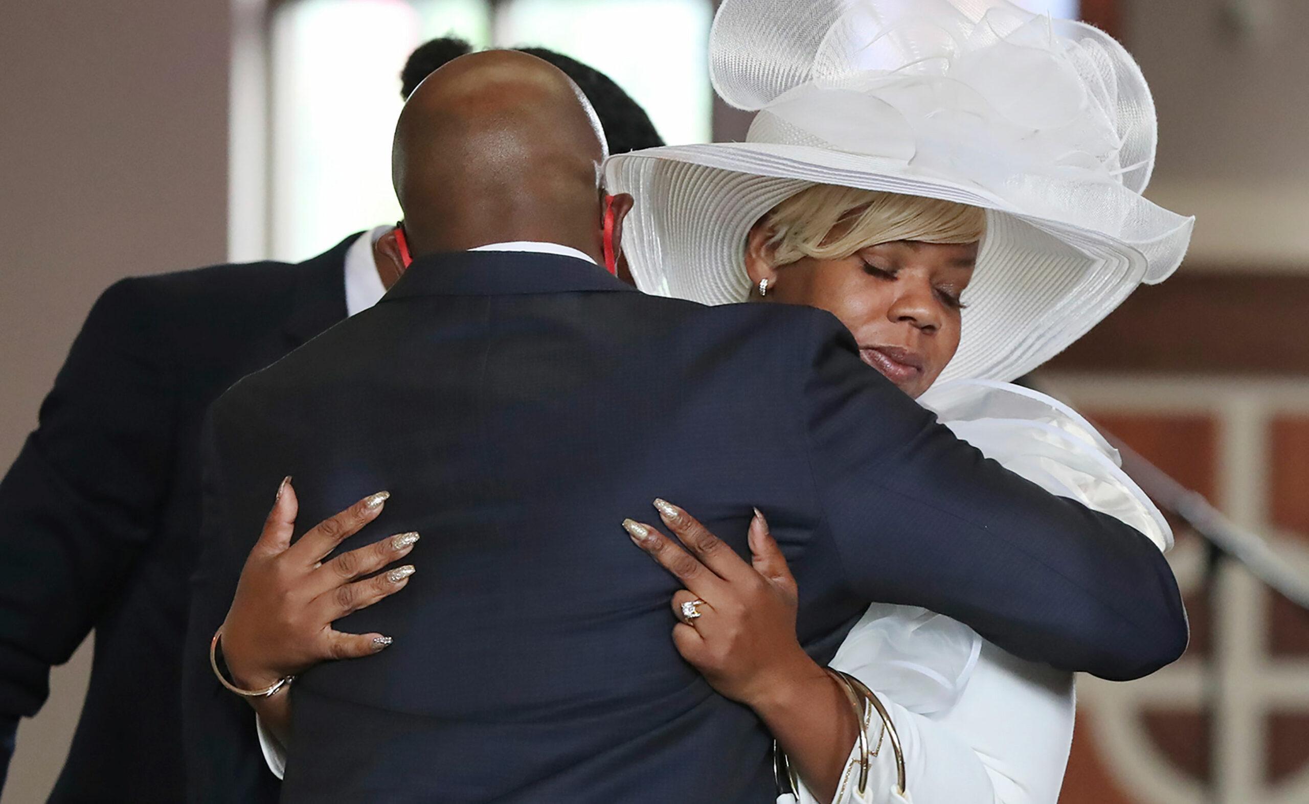Rev. Raphael G. Warnock comforts Tomika Miller, the wife of Rayshard Brooks, during Brooks' public viewing at Ebenezer Baptist Church on Monday, June 22 in Atlanta.
