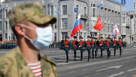 A Russian soldier wears a mask in Lenin Square during a parade.