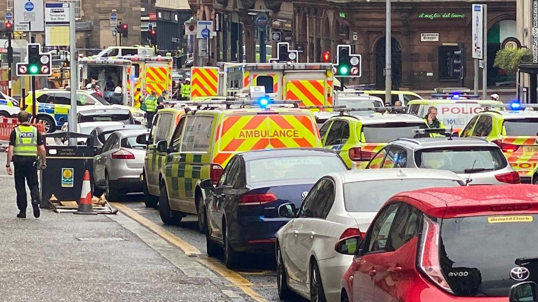 Police descend into downtown Glasgow after a police officer is stabbed