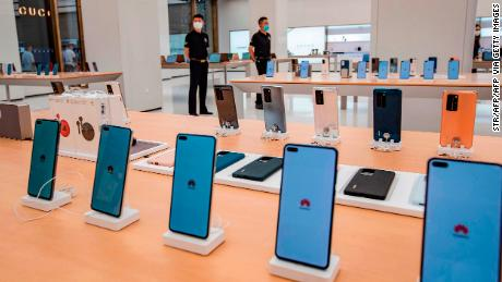 The smartphones are on display at the Huawei store ahead of this month's opening in Shanghai.