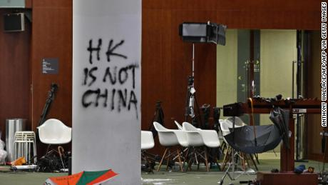 Graffiti and umbrellas were seen in front of the main chamber of the Legislative Council during a media tour of Hong Kong on July 3, 2019, two days after protesters broke into the complex.