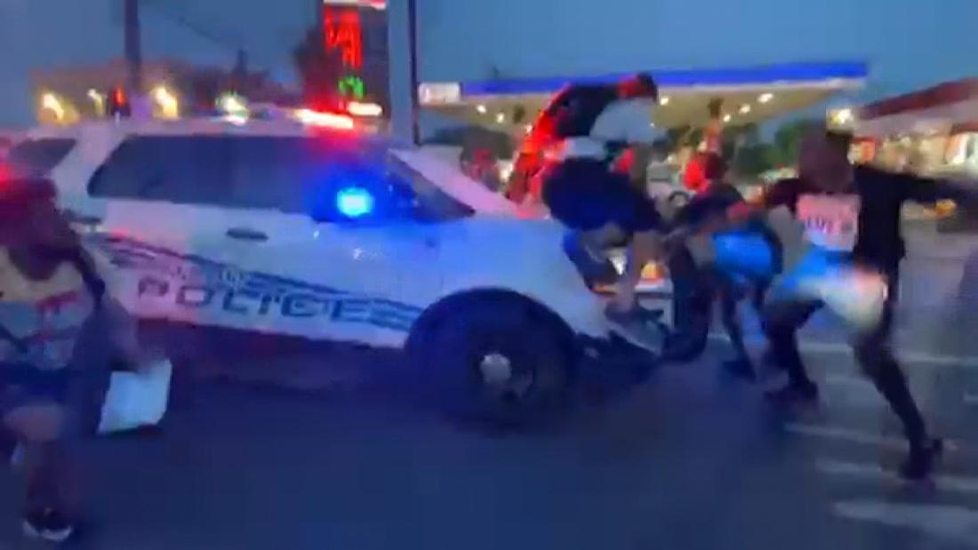 A video has appeared showing a Detroit police car driving into the protesters