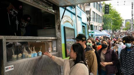 People line up for samples of Ben & amp; Jerry's ice cream during the ongoing Black Lives Matter events at the so-called Capitol Hill organized protest