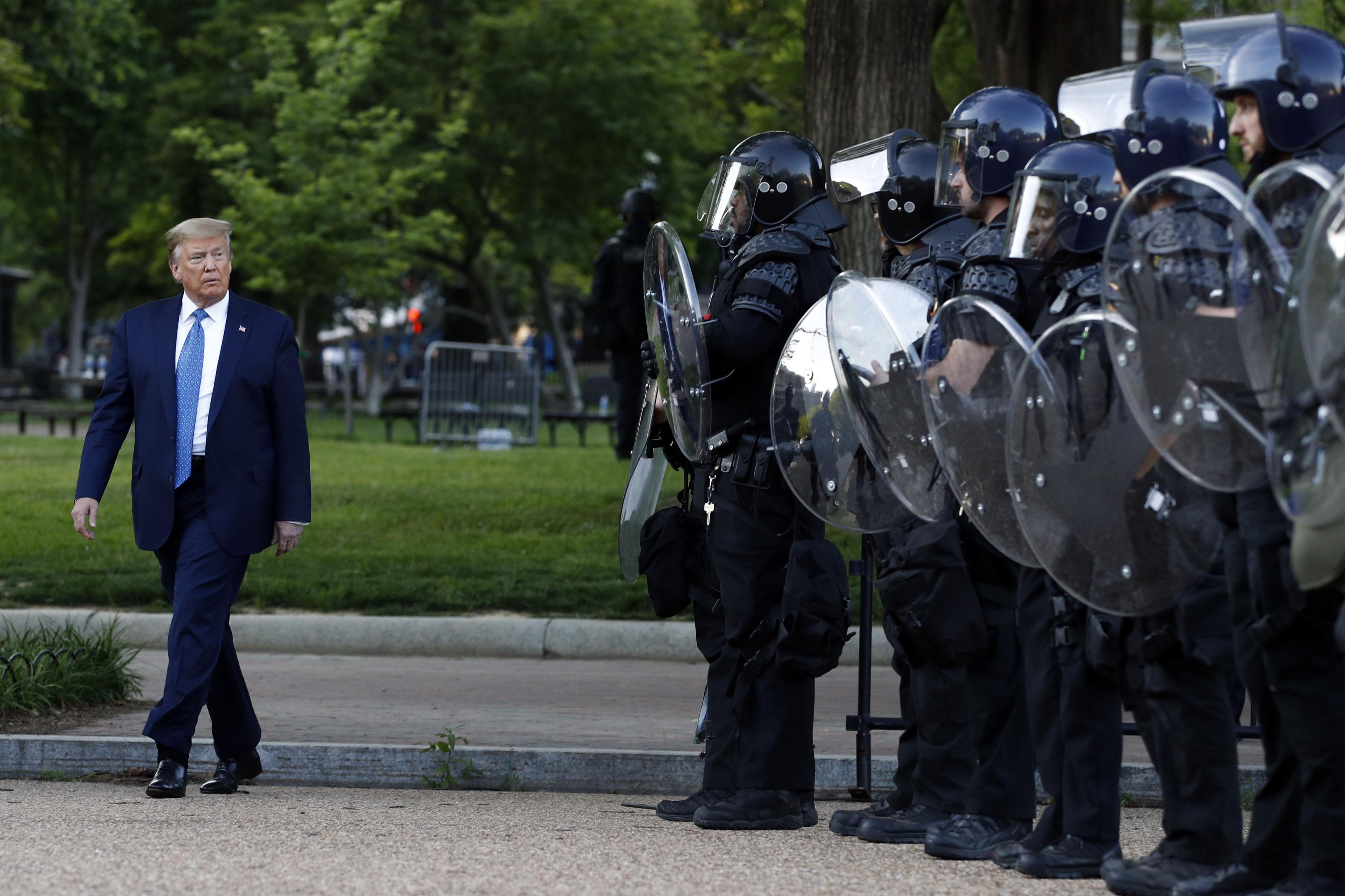 President Donald Trump walks past police officers in Washington's Lafayette Park on June 1st.
