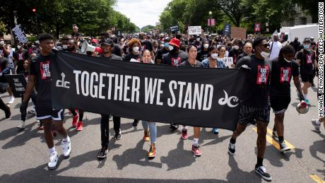 Washington Wizards players, Washington Mystics players and supporters are participating in the March 16 observation march in Washington, DC.