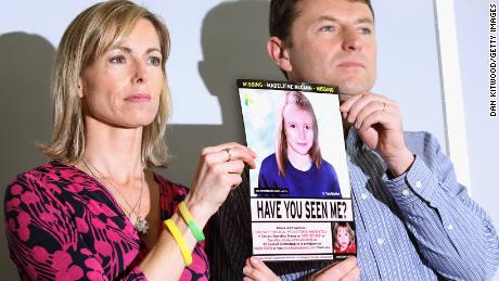 Kate and Gerry McCann hold an age-old police image of Madeleine during a press conference in London on the occasion of the 5th anniversary of her disappearance in May 2012.