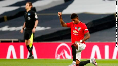 Manchester United striker Marcus Rashford takes the knee.