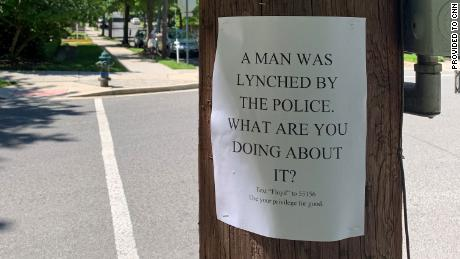 A man and two women were placing flyers in support of the Black Lives Matter when the man charged them, the statement said.