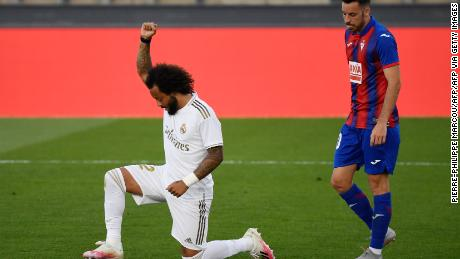 Marcelo knelt on one knee and raised his fist in solidarity with the Black Lives Matter movement after scoring Real's third goal.
