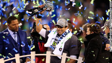 Wilson celebrated with Vince Lombardi's trophy after beating the Denver Broncos 43-8 in the 2014 Super Bowl XLVIII 2014.