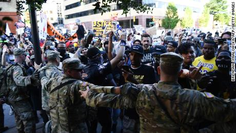 Members of the National Guard created an obstacle to stop protesters near the center of the Oklahoma Bank in Tulsa.