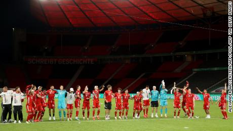Bayern players celebrate winning the German Cup in a completely empty Olympiastadion.