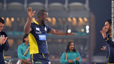 Sammy dances with teammates on stage before the start of the last cricket match of the Pakistani Super League.