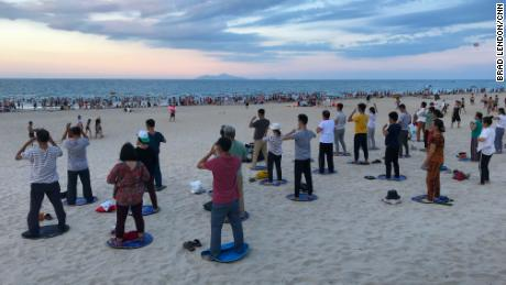 Locals gather for tai chi and swimming at My Khe beach in Da Nang, Vietnam. During the Vietnam War, the Americans called this Chinese beach.