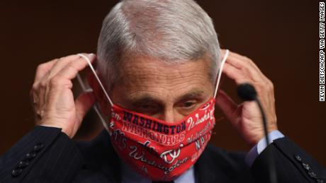 Amid coronavirus surge, health officials urge people to wear masks as a symbol of respect