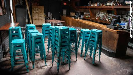 Chairs sit stacked inside a closed bar in Austin, Texas.