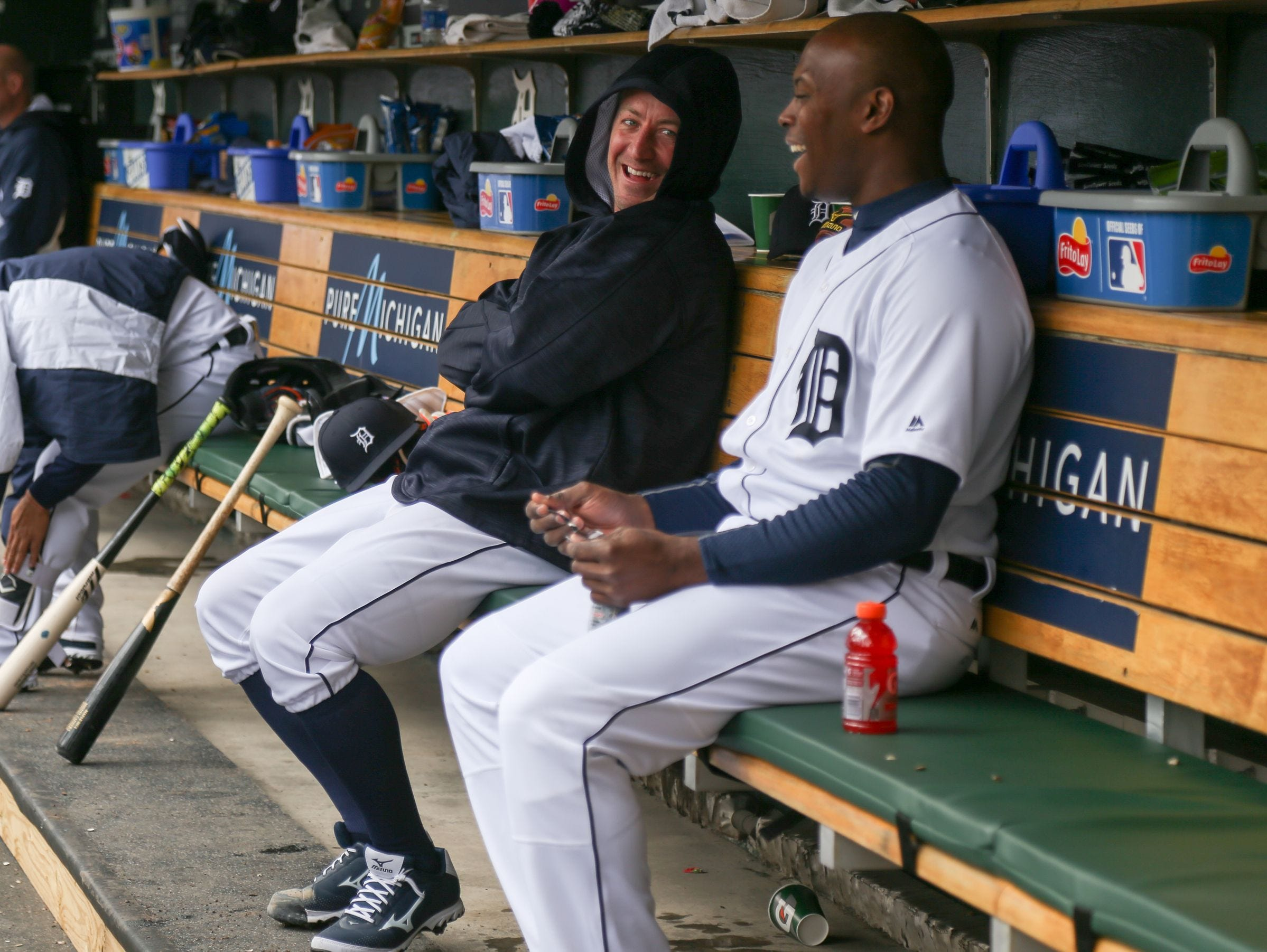 Detroit Tigers' Jordan Zimmermann has a laugh with Justin Upton on the bench during the Opening Day game against the New York Yankees at Comerica Park in Detroit on Friday, April 8, 2016.