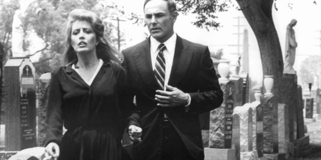 Ronee Blakley and John Saxon walking through a cemetery in a scene from the film 'A Nightmare On Elm Street,' 1984. (Photo by New Line Cinema/Getty Images)