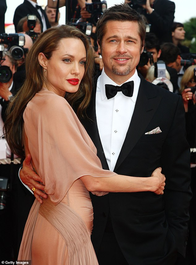 Working together: A source told Entertainment Tonight last month after another visit: 'Brad and Angelina have come a very long way and they're finally in a place where they both want to work together to raise their kids' (pictured in May, 2009)