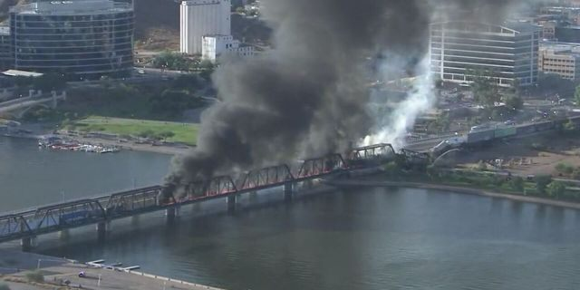 A train bridge partially collapsed after a derailment and fire in Tempe, Ariz. on July 29, 2020.