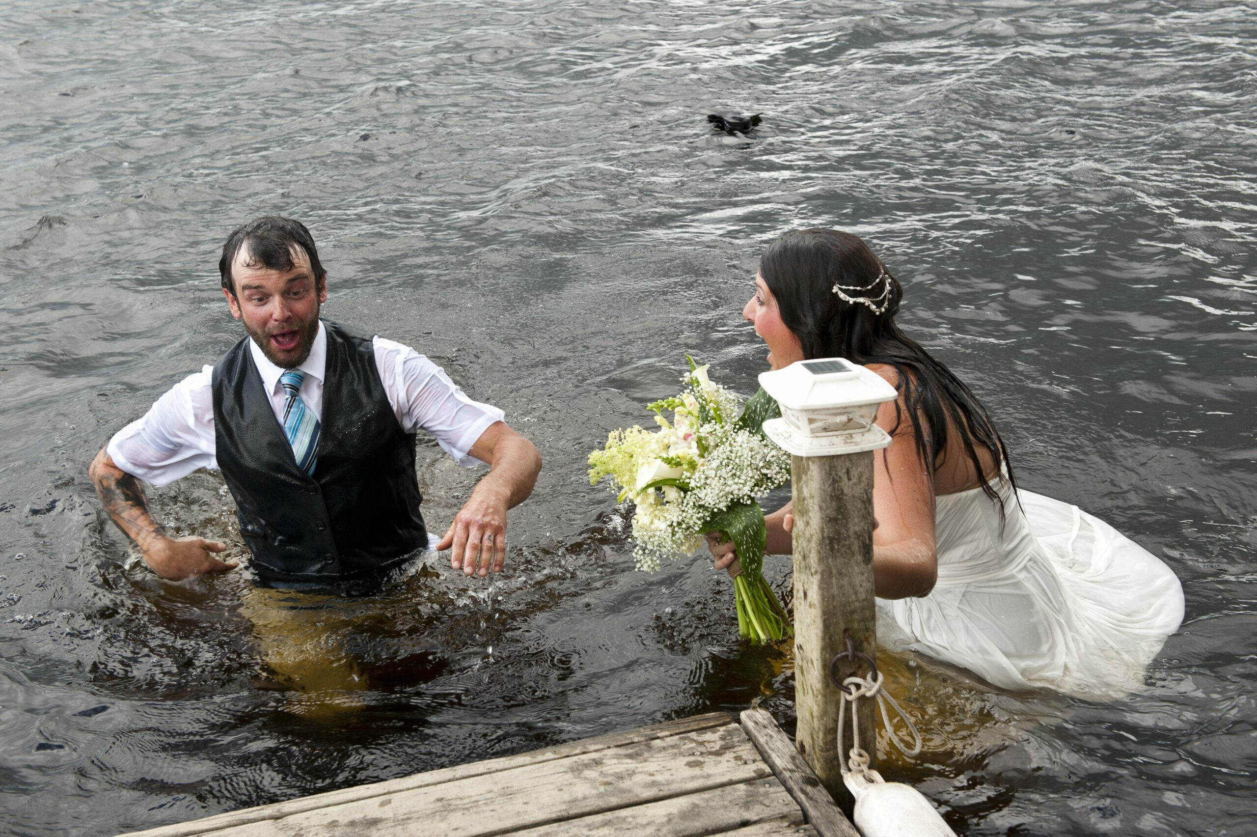 Bride, groom fall into river during wedding photos while attempting 'romantic' dance move