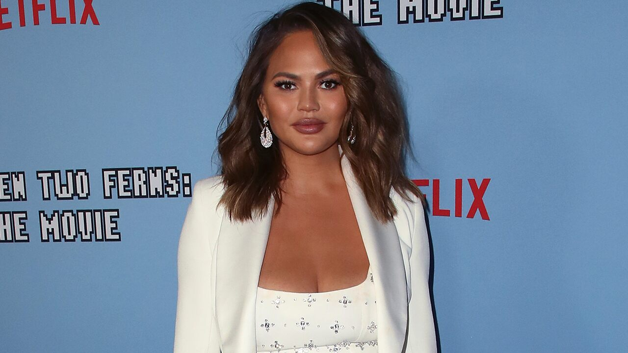 Chrissy Teigen posts video of breast implant removal scars because 'nobody believes' she had surgery