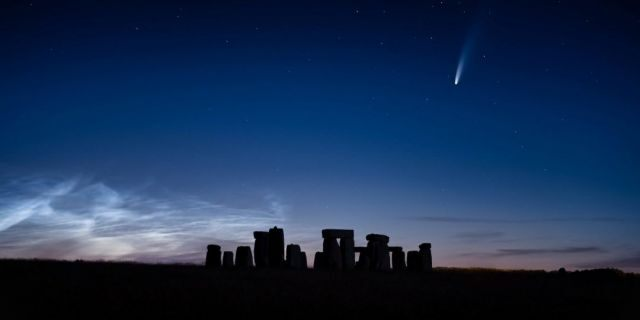 A blazing comet that has traveled for 6,800 years was seen streaking over Stonehenge on a perfect summer's evening. (Credit: SWNS)
