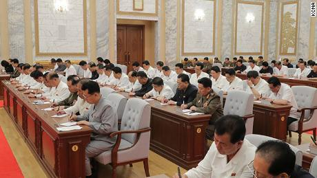 North Korean leader Kim Jong Un was seen at a meeting on Thursday in this photo provided by KCNA. Officials do not appear to wear masks or practice social distancing.