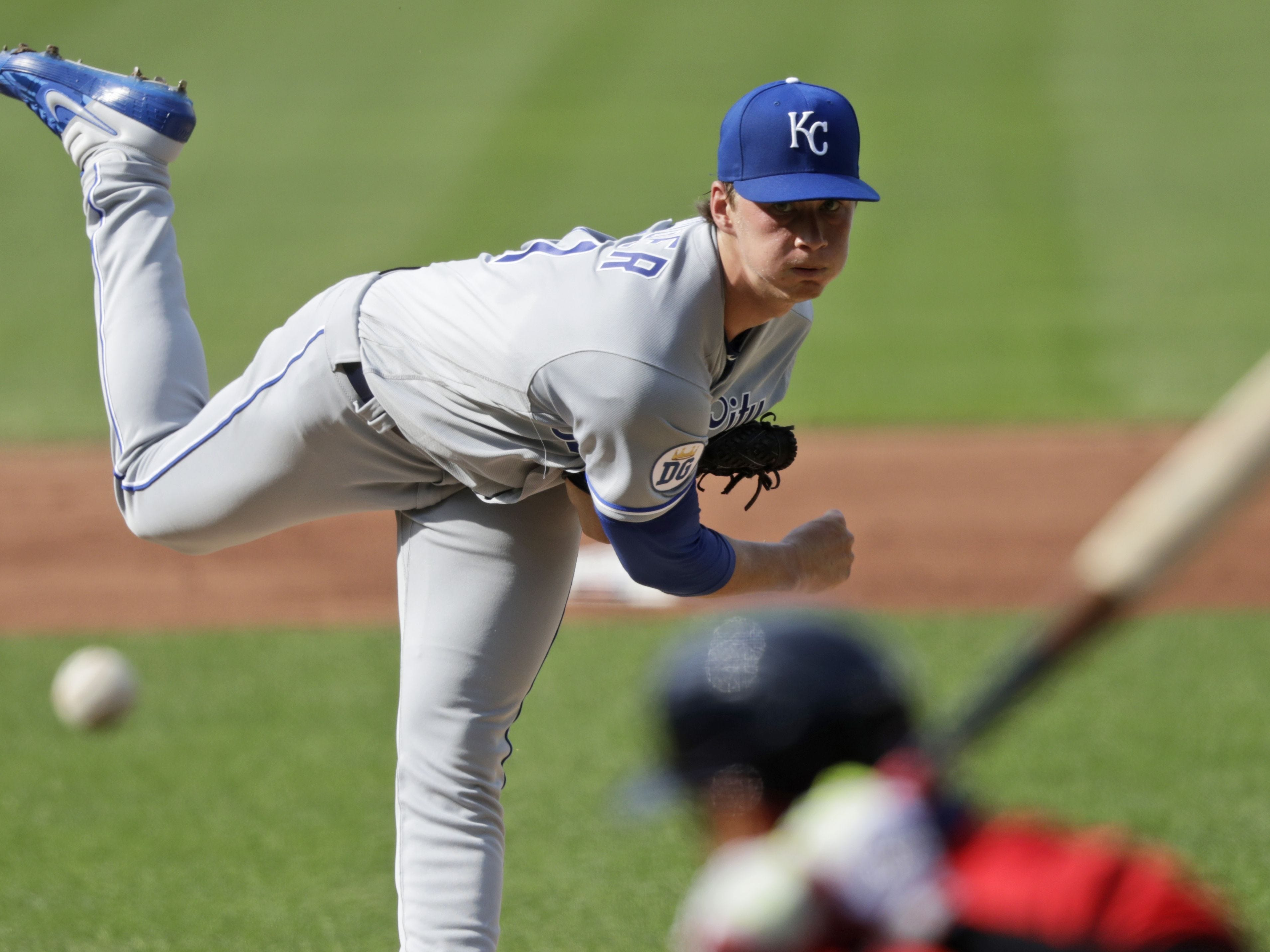 Kansas City Royals starting pitcher Brady Singer delivers to Cleveland Indians' Cesar Hernandez in the first inning in a baseball game Saturday, July 25, 2020, in Cleveland. (AP Photo/Tony Dejak)