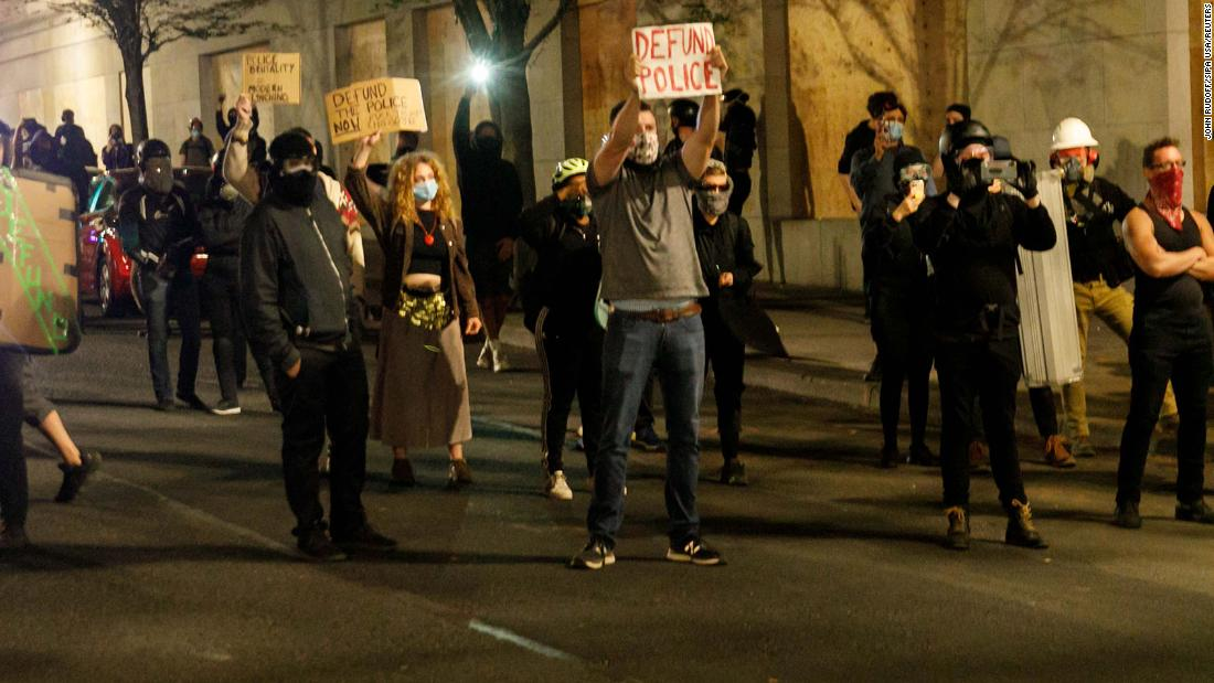 Protesters requested to depart or hazard arrest following Portland Police Association business is established ablaze