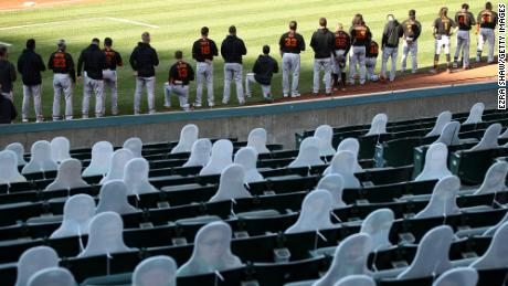 San Francisco Giants players seen kneeling during the national anthem  on July 20.