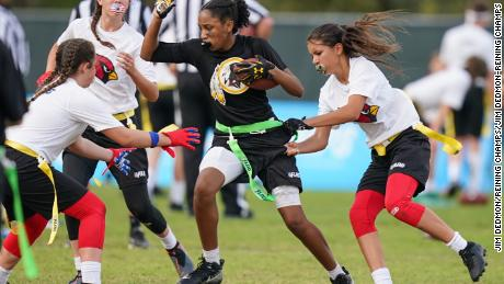 Players participate in the first day of games at the NFL Flag Football Championship.