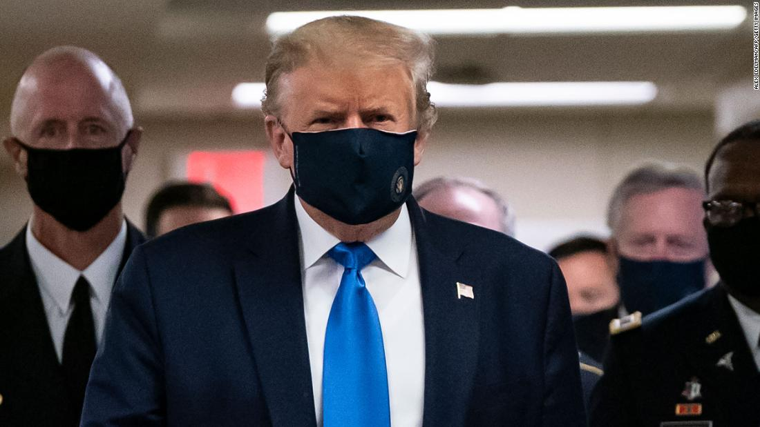 Trump wears a mask during visit to wounded service members at Walter Reed