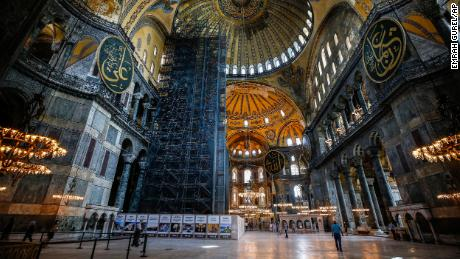 People visit the Byzantine-era Hagia Sophia, one of Istanbul's main tourist attractions, on June 25, 2020.