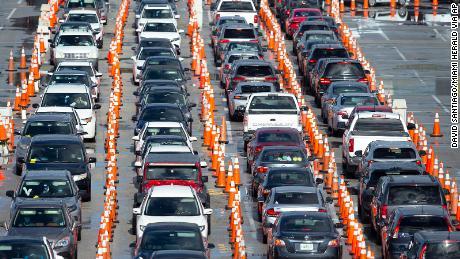 Vehicles line at a coronavirus testing center in Miami Gardens on Sunday.