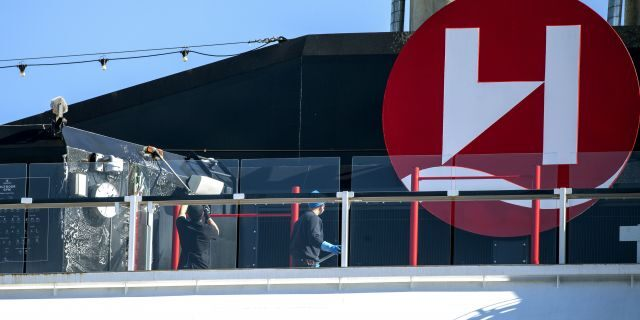 Crew members clean on board Hurtigruten's vessel MS Roald Amundsen on Aug. 2. (Terje Pedersen/NTB scanpix via AP)